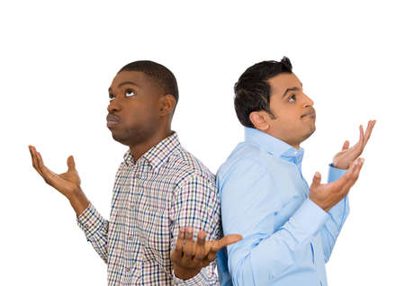 clueless: Closeup portrait of two men back to back putting hands in air looking up in frustration, isolated on white background. Negative human emotion facial expression feelings. Miscommunication conflict