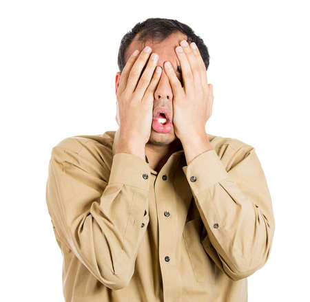 mexican: Closeup portrait of shocked, horrified, worried, stressed young guy, nervous man with hands on face, isolated on white background. OMG. Negative human emotions, facial expressions, perception, feeling