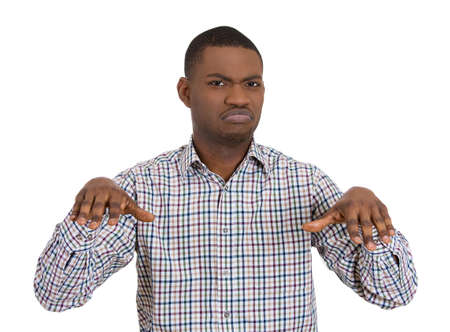 Closeup portrait of angry mad young pissed off man gesturing with his hands that he is very disgusted by something, isolated on white background. Negative emotion facial expression feelings. photo