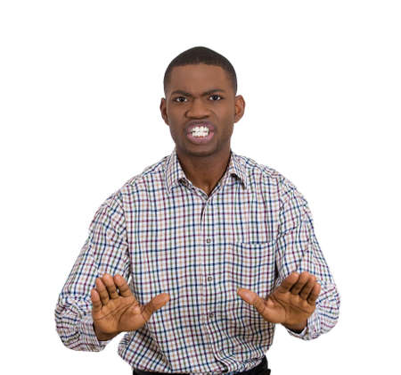 Closeup portrait of handsome shocked mad young man raising hands up to say no stop right there, isolated on white background. Negative human emotion facial expression feelings, signs and symbol photo