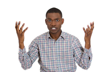 animosity: Closeup portrait of angry man with hands raised, looking at you distressed, isolated on white background. Negative emotion, facial expression, feelings, attitude, perception Conflict problems, issues.