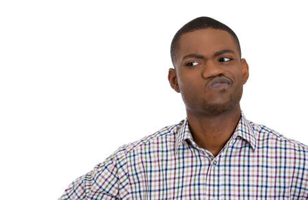 confused face: Closeup portrait of skeptical young man looking suspicious and some disgust on his face, mixed with disapproval, isolated on white background. Negative human emotion, facial expressions, feelings