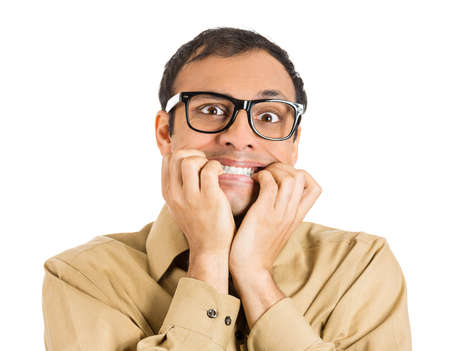 Closeup portrait of a nerdy guy, anxious man with big glasses, biting his finger nails craving something scared, looking at you isolated on white background. Negative human emotion, facial expressions Stock Photo