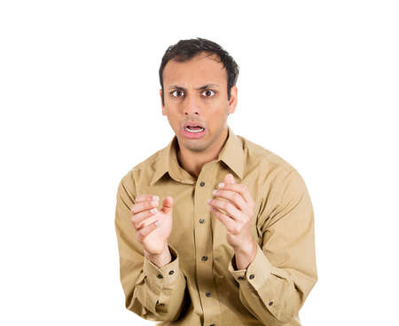 astonished: Closeup portrait of scared man, shocked guy, puzzled employee, looking at you with opened mouth trying to predict what is next, in anticipation of unpleasant situation, isolated on white background.