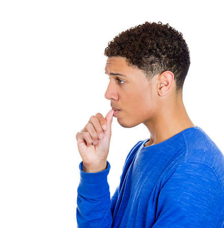 perfectionist: Closeup side view profile portrait of man with finger in mouth, sucking thumb, biting fingernail in stress, deep thought, isolated on white background. Negative emotion, facial expression, feelings