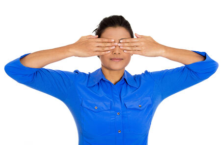 withhold: Closeup portrait of young pretty woman, closing, covering eyes with hands cant look, hiding, avoiding situation, isolated on white background. See no evil concept. Human emotions, facial expressions Stock Photo