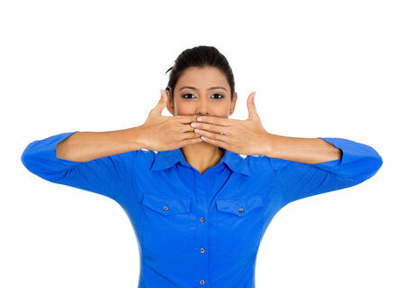 shut: Closeup portrait of young woman covering closed mouth, open eyes. Speak no evil concept, isolated on white background. Negative human emotion facial expressions signs and symbols. Media news coverup