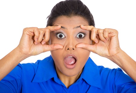 Closeup portrait of surprised, shocked, astonished young woman with wide open mouth, in full disbelief, keeping her focus, isolated on white background  Negative facial expressions, emotions, feelings Stock Photo