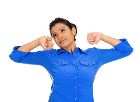 extending: Closeup portrait of pretty beautiful tired fatigued woman stretching extending arms, back, shoulders , yawning, isolated on white background  Positive emotion facial expression feeling Stock Photo