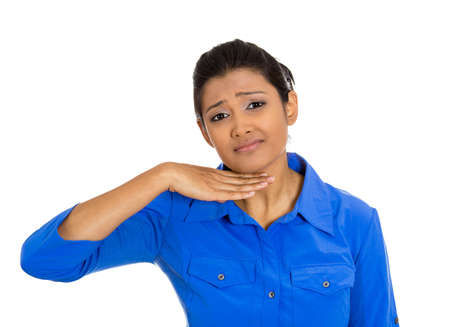 cut off head: Closeup portrait of angry young woman gesturing with hand to stop talking, cut it out, or that she will take your head off, isolated on white background  Negative emotion, facial expressions, feelings