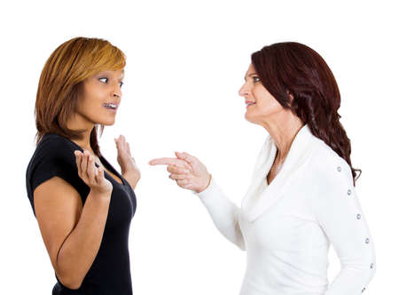 interpersonal: Closeup portrait of two angry upset women, one blames the other for something wrong who is surprised offended, isolated on white background. Negative emotion facial expression. Interpersonal conflict Stock Photo
