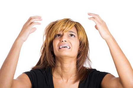 heartbreak issues: Closeup portrait of overwhelmed, depressed, unhappy,upset young beautiful woman with arms raised in air looking upwards, isolated on white background. Negative human emotion facial expressions Stock Photo