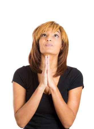 Closeup portrait of young woman with opened eyes praying hoping for the best, asking for forgiveness, miracle isolated on white background. Positive human emotions, facial expressions, feelings Stock Photo - 25885332