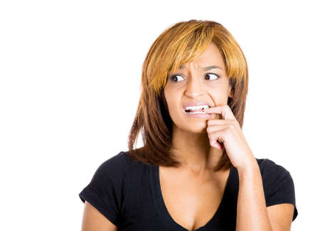 worried woman: Closeup portrait of young unhappy woman biting her nails and looking to side with a craving for something or anxious worried isolated on white background. Negative emotion facial expression feelings