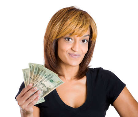 free me: Closeup portrait of super happy excited successful young woman holding money dollar bills in hand, isolated on white background. Positive emotion facial expression feeling. Financial reward savings