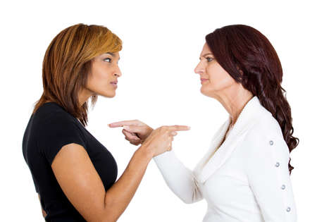 unhappy worker: Closeup portrait of two mad angry women pointing fingers at each other, blaming for problems, isolated on white background. Interpersonal conflict strife. Negative emotions facial expression feeling Stock Photo