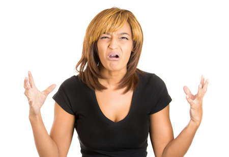 Closeup portrait of a happy cute young beautiful woman looking shocked and surprised in full disbelief arms up in air, isolated on a white background. Negative human emotions and facial expressions photo