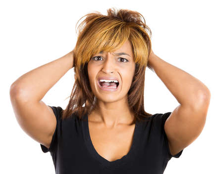 going crazy: Closeup portrait of a young, attractive stressed woman who is going crazy pulling her hair out with hands in frustration, isolated on a white background. Negative human emotions facial expressions