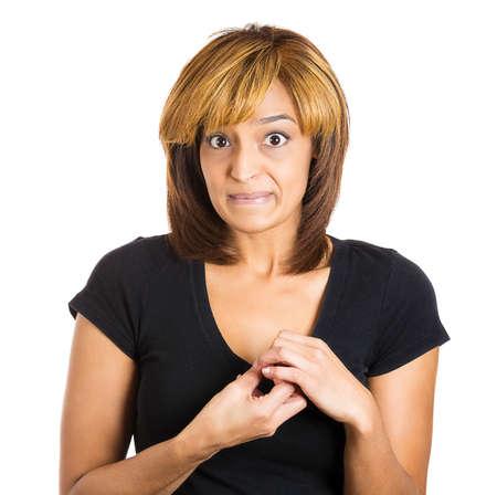facial gestures: Primer retrato de una mujer joven que le mira diciendo lo siento he cometido un error a trav�s del lenguaje corporal y gestos con las manos. Aislado en el fondo blanco. Emociones humanas negativas expresiones faciales sentimientos