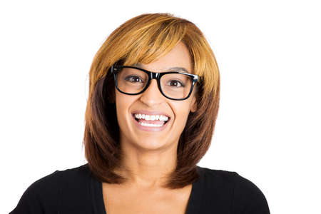 dweeb: Closeup portrait head shot of young beautiful smiling teeth nerdy computer geek woman with black eye glasses frames, isolated on white background. Positive human emotion facial expression