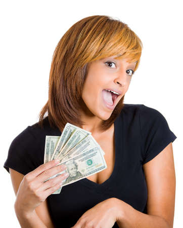 arabic currency: Closeup portrait of super happy excited successful young woman holding money dollar bills in hand, isolated on white background. Positive emotion facial expression feeling. Financial reward savings