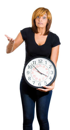 pressured: Closeup portrait of a stressed woman holding clock looking anxiously , pressured by lack of time, running out, isolated on a white background. Negative facial expression emotion feelings
