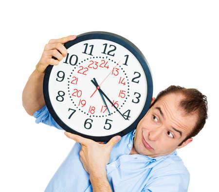 hectic life: Closeup portrait of business man funny looking student holding clock stressed running out pressured by lack of time guy overwhelmed boy, late for meeting isolated on white background. Negative emotion