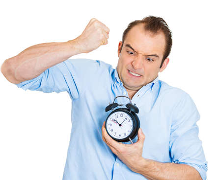 requesting: Closeup portrait of angry, demanding boss, business man, funny looking guy, holding alarm clock, screaming, requesting employees to be on time pushing for project deadline isolated on white background