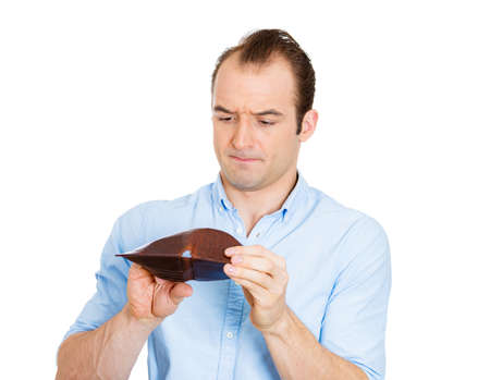 sad man: Closeup portrait of sad, upset, unemployed broke guy, fired employee, jobless business man, holding looking into his empty wallet, isolated on white background. Bankruptcy, financial problems mistakes