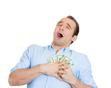 Closeup portrait of happy excited successful business man in love with money, funny looking guy holding dollar bills in hand isolated on white background. Human emotions, facial expressions, feelings. Stock Photo