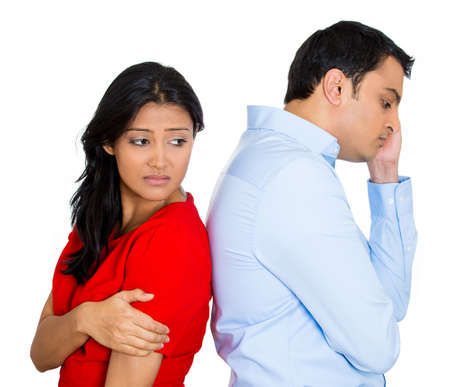 Closeup portrait of two people, couple woman and young man, back to back, very sad, disappointed with each other, isolated white background. Marriage, relationship problems. Negative facial reaction photo