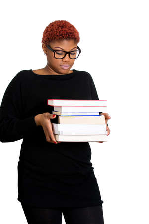 dweeb: Closeup of a young dorky dweeb woman, wearing big glasses, holding books, anxious in anticipation of finals, exam test, isolated on white background. Negative facial expressions, feelings, emotions Stock Photo