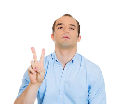 imperious: Closeup portrait of sarcastic young funny looking man showing v sign super confident with patronage on his face, isolated on white background. Human emotions, expression, attitude, perception of life