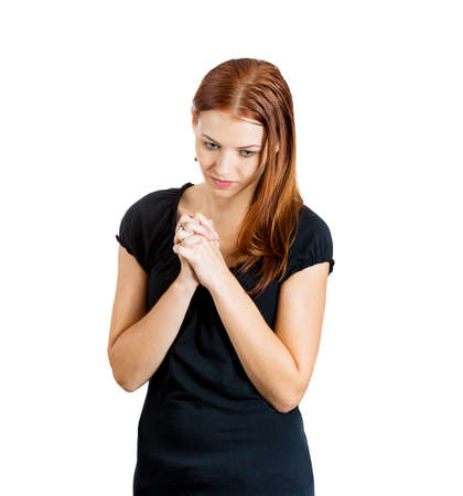 Closeup portrait of young woman looking downwards praying hoping for the best, asking for forgiveness, miracle isolated on white background. Positive human emotions, facial expressions, feelings photo