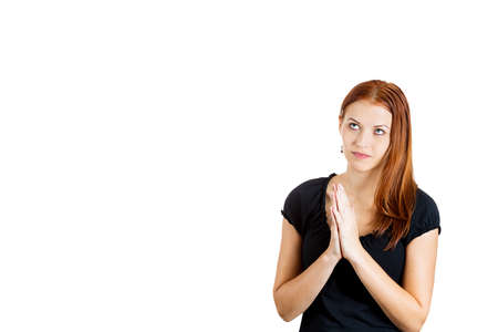Closeup portrait of sad, hopeful young woman who prays, hopes, asks begs for best, going through tough times in her life, isolated on white background. Positive emotions, facial expressions, feeling photo
