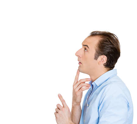 Closeup side view profile portrait of handsome, funny looking young man pointing with finger as if he trying to solve problem isolated on white background with copy space. Positive human emotions photo