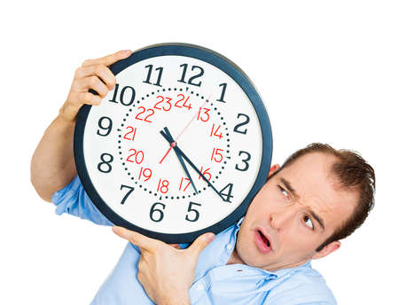 overwhelmed: Closeup portrait of business man funny looking student holding clock stressed running out pressured by lack of time guy overwhelmed boy, late for meeting isolated on white background. Negative emotion