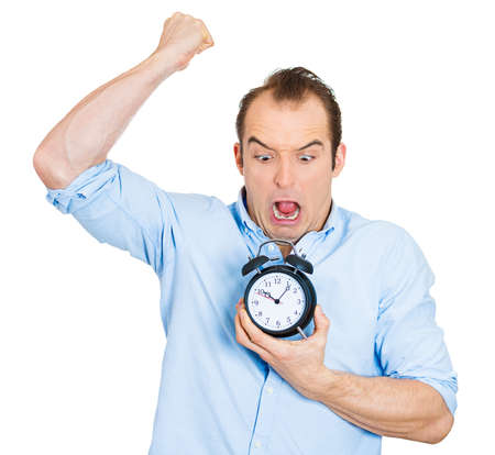 requesting: Closeup portrait of angry mad demanding boss business man funny looking guy holding alarm clock, screaming, requesting employees to be on time pushing for project deadline isolated on white background Stock Photo