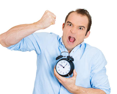 Closeup portrait of angry, demanding boss, business man, funny looking guy, holding alarm clock, screaming, requesting employees to be on time pushing for project deadline isolated on white background photo