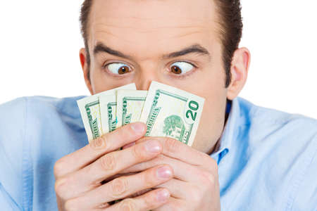 pennypinching: Closeup portrait of greedy banker, CEO boss, corporate employee funny man fascinated, obsessed with money holding, staring at dollar banknotes scared to loose isolated on white background. Expressions