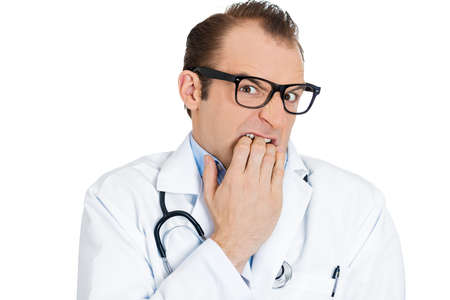 pervert: Closeup portrait young insecure male doctor with black glasses biting fingernails looking funny scared craving something anxious, isolated on white background. Human facial expression, emotion feeling