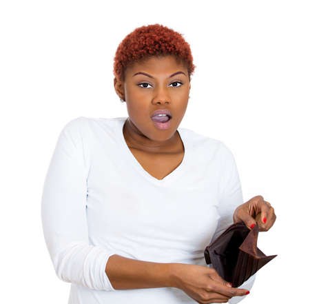 Closeup portrait of shocked, upset, sad, unhappy young woman standing showing empty brown wallet, isolated against white background. Financial difficulties, bad economy concept. Negative emotion photo