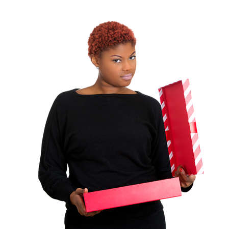 hedonism: Closeup portrait of young upset bothered woman receiving gift very displeased with what she received, isolated on white background. Negative emotion facial expression feeling, attitude