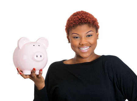 Closeup portrait of young woman holding her piggy bank friend in hand, isolate on white background. Positive emotion facial expression feelings. Smart wise saving paid financial decisions. Nest egg Stock Photo - 26105300