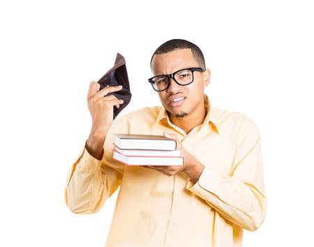 Closeup portrait of young student man holding books and empty wallet, looking distressed that he has no more money is broke, isolated on white background. Education value Stock Photo - 26105332
