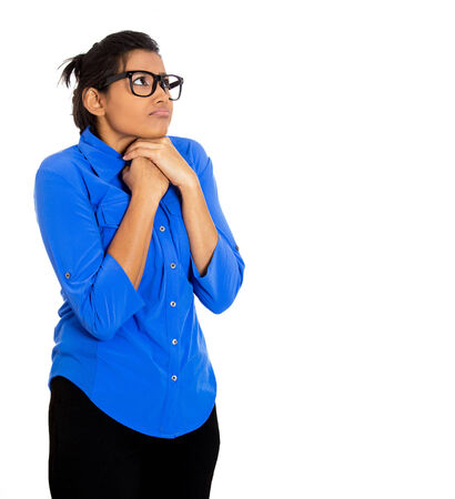 shy woman: Closeup portrait of a young nerdy looking woman with big glasses, very timid suspicious shy and anxious looking away up isolated on white background. Mental health, emotion facial expression feeling Stock Photo