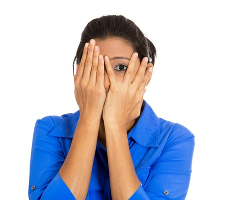 cant: Closeup portrait of young scared terrified horrified shocked woman peeking through covered hand, cant believe what she sees, isolated on white background. Negative emotion facial expression feelings.
