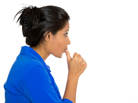postpone: Closeup side view profile portrait of woman with finger in mouth, sucking thumb, biting fingernail in stress, deep thought, isolated on white background. Negative emotion, facial expression, feelings