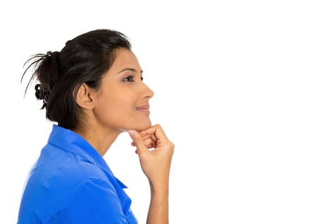 thoughtful woman: Closeup side view profile portrait of young pretty smiling young woman, student, worker, daydreaming, isolated on white background. Positive emotion facial expressions feelings attitude perception. Stock Photo