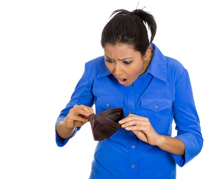 latina girl: Closeup portrait of shocked, upset, sad, unhappy young woman standing showing empty brown wallet, isolated against white background. Financial difficulties, bad economy concept. Negative emotion